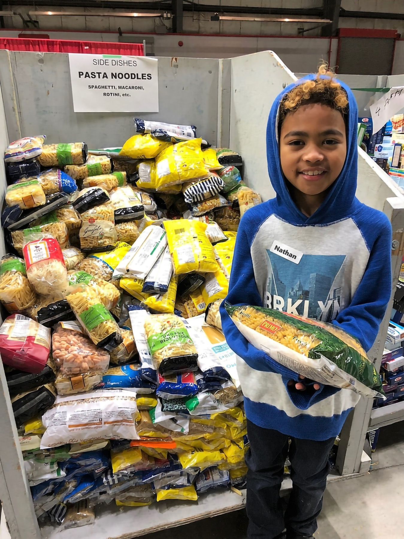 Student in front of food hamper