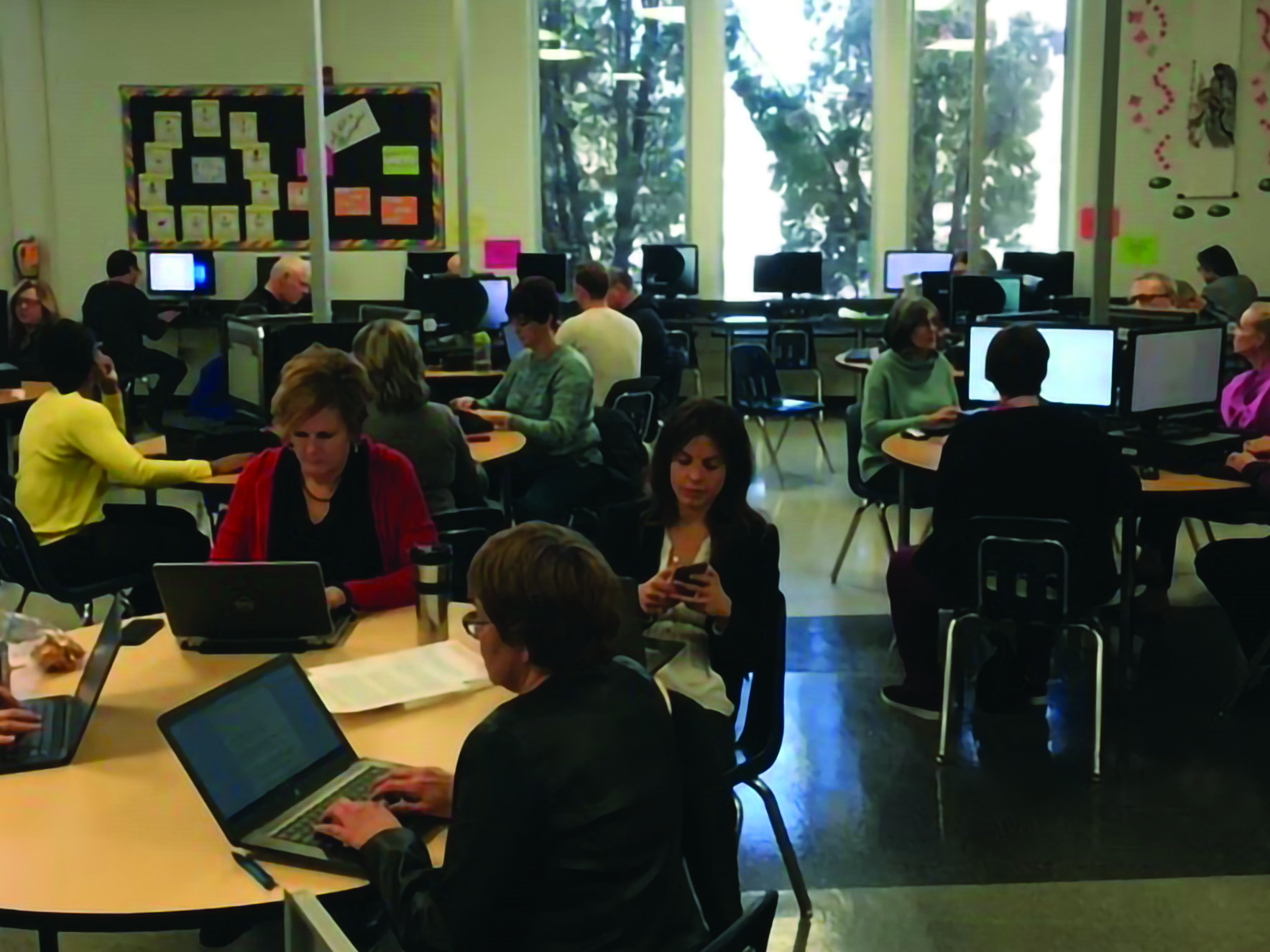 Holy Cross High School teachers participate in the research survey