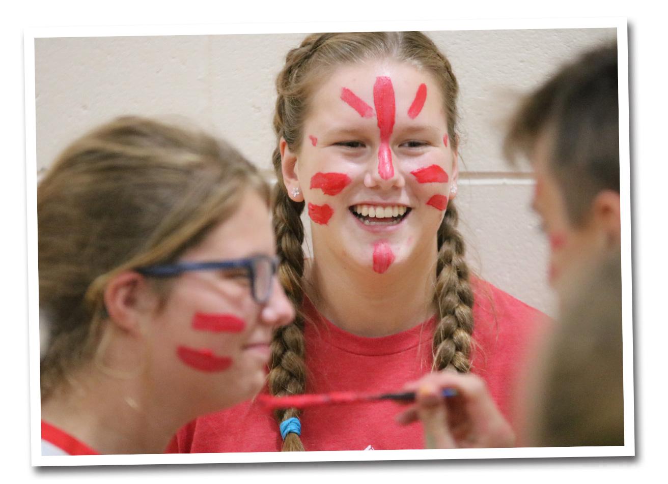 Students paint faces