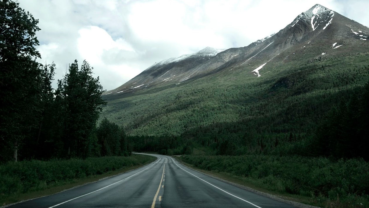 The road curves into the distance in Valdes, Alaska